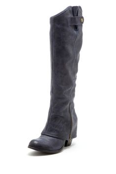 """Fergie  Ledger Too Almond Toe Tall Boot  Show the style competition how these chic boots were made for walking.   - Almond toe  - Overlapping shaft with lower side zip closure and top side goring panel with strap and snap button closure  - Stacked chunky heel  - Approx. 16"""" shaft height, 14.5"""" opening circumference  - Approx. 2.75"""" heel  $170.00"""
