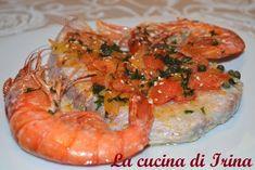 Ingredienti: - 4 fette di tonno - una cipolla bianca - 400g di pomodori a filetti in scatola - un cucchiaio di pangrattato - cappe...