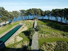The swimming pool has been made in lava stone from the region.   Landscape architect Erik Dhont