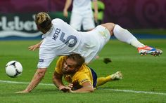 JUNE 19:  Philippe Mexes of France falls on Olof Mellberg of Sweden during the UEFA EURO 2012 group D match between Sweden and France at The Olympic Stadium on June 19, 2012 in Kiev, Ukraine.