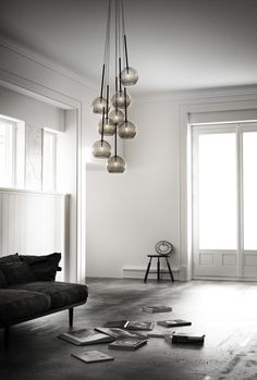 I love clusters of lights like this, but is it just me or does it look like each of these lights just shat out a book?