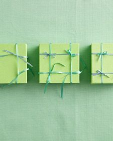 unique way to tie a ribbon on a package called the four bow box. hmm...curious.