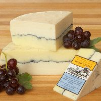 Carr Valley Mobay: a delicious take on the famous French cheese, Morbier. Features a layer of sheep milk cheese and a layer of goat milk cheese separated by a layer of grape vine ash and pressed together. The flavor is both delicate and rustic. Serve with Reisling.