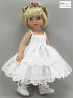 Doll dress, made from one hankie, has peachy flowers plus yellow daisies & blue tulips.  Scalloped edge has hunter green along the hem to match the bodice.  Dress is lined with scalloped, embroidered lace.  The 2nd dress, a sun dress, has double rows of ruffled lace, adorned by bows and pearls.  Floral hatband has 8 flowers on elastic. For 10-inch Ann Estelle (shown in photo) and Patsy dolls, all by Hankie Couture, sold on Ebay for $52 in May 2015 #doll #Patsy #Tonner #handmade #sewing #lace