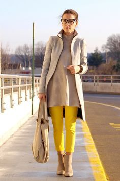 elegant beige outfit spiced with yellow pants