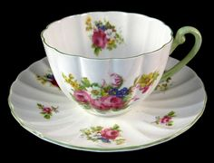 This is a Shelley China, England cup and saucer in the Hulmes Rose pattern 13240 and the Ludlow shape with green trim made 1940-1966. The cup is 2.4 inches high  78.00
