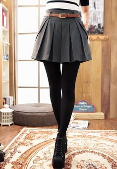 This is an example of how to wear skirts in the Winter. Plain black leggings allow you to wear any kind or color of skirt. And we cant forget about the shoes. Who doesnt love these shoes?