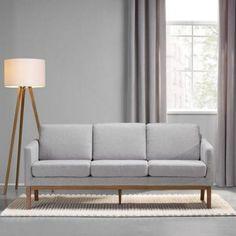 <p>Dieser Artikel ist NUR ONLINE erhältlich!</p><p>Dieses schicke Sofa bietet Ihnen einen Sitzplatz mit Retro-Charme für Ihr Zuhause. Gerade Linienführung und eine attraktive Kombination von Beige und Grau verleihen dem ca. 194 x 80 x 76 cm (B x H x T) großen Sofa eine ansprechende Note. Ein strapazierfähigerBezug aus Polyester und robuste Füße aus Massivholz in Braun machen den Dreisitzer gut kombinierbar zu verschiedenen Einrichtungsstilen. Die weiche Schaumstoffpolsterung sorgt für…