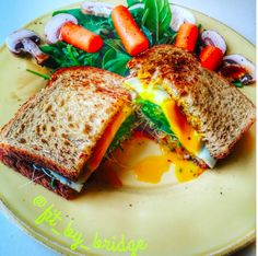 Fried Egg Sandwich  Two pieces of toasted wheat bread, grainy mustard, fried tomato slices, spinach, sprouts, onions with, of course, a fried egg!
