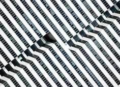 """Hypnotic, 2014. """"The saturated facade of this late-modernist 1981 office building in Houston, Texas, exposes the inner paths of its elevators, outlining the dramatic black-and-white lines with glass and aluminum,"""" notes Olic."""