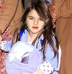 Made up little madam: Suri Cruise sports glossy red lips as she jets off in helicopter with Katie Holmes Katie Holmes, Tom Cruise, Red Lipsticks, Beautiful Creatures, Aries, Lady In Red, Parenting, Nyc, Children