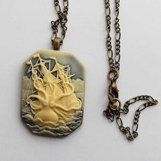 Neck knot consisting of a very thin chain and a brass knot pendant An adorable fantasy!