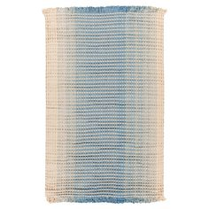 Anchor your living room or define a space in your master suite with this hand-woven rug, showcasing an ombre motif in green and blue.  ...