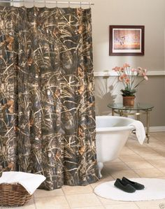 Mixing manly with classy using camo curtains browning bathroom
