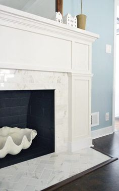 Like this fireplace. never thought of small tiles around the fireplace ~ Shiny white marble. Fireplace Makeover: Stick A Fork In It Fireplace Redo, Fireplace Hearth, Fireplace Remodel, Fireplace Surrounds, Fireplace Design, Fireplace Ideas, Fireplace Tile Surround, Fireplace Modern, Tile Around Fireplace