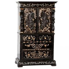 Anglo-Indian miniature cabinet made of solid ebony with ivory inlay and additional ebony carved details.