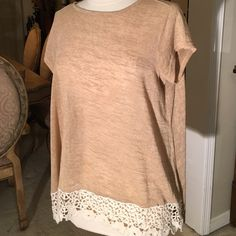 Shirt with lace fringe in front hi low Super cute high low top with lace detail in the front very comfortable new without tags never been worn Tops