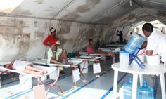 A Cholera Treatment Center in Carrefours run by MSF. For the most serious cases, seen here, patients' lives are saved using IV hydration. Credit: Jude Stanley Roy/IPS