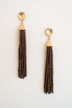 Bead all about it: there's not much explaining to do about these G O R G E O U S brown beaded earrings. Dangle style featured from a gold, stud style piece. Post style back. Add these beauties to any