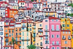 MENTON, COTE D'AZUR, FRANCE ~ Houses in bright colors along the streets of the old town area of MENTON, on the French Riviero, near Nice.