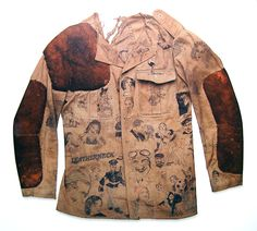 """""""Girl in Every Port"""" Customised US Marines Cotton Jacket. The deerskin leather patches were attached later for gun shooting. The hand-painted graphics were added by original owner. Circa 1910."""