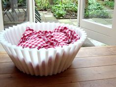 a giant synthetic cupcake patty; perfect for pets, plants or paddling