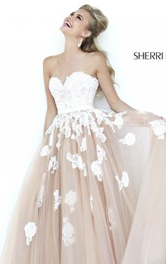 Create a feminine flair in Sherri Hill 11200. This eye-catching evening gown features a strapless and sweetheart neckline. Embellished lace covers the bodice and fades down as it reaches the hem. The ballgown skirt adds volume for a fantastic look.