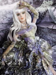 Oz's Dazzling Tyler Wentworth 2011 #fashion #dolls Rich Lavender - a woman swimming in lush color.