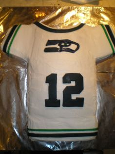 Seahawks Jersey Cake - This is a Seahawks jersey shaped cake for a boy's birthday.