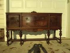 Antique sideboard buffet Looks like the one in my kitchen. Can't find additional info.