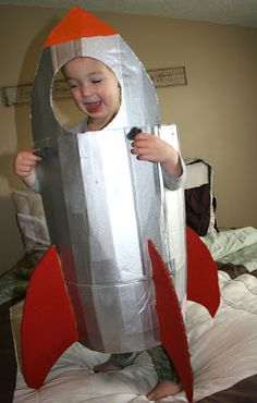 DIY rocket costume.  Cutest astronaut ever!
