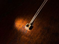 WOLFEN GERMANY Necklace cube. Made in Berlin.