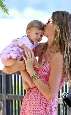 Gisele Bundchen & Vivian <3 this family Vivian is going to grow into such a beautiful lady!!
