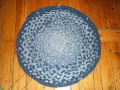 Raggedy jeans won't go to waste! .  Free tutorial with pictures on how to make a rag rug in 9 steps by braiding with thread, fabric scissors, and jeans. How To posted by Deidra L. Difficulty: 3/5. Cost: No cost.