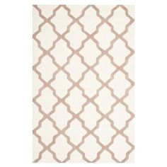 Featuring a trellis motif in ivory and beige, this hand-tufted wool rug adds a sophisticated touch to your living room or master suite.   ...