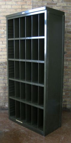 Wow! A stunner. Old GE record cabinet from a radio station. Metal shelving like this is the absolute best for record storage but you simply can't get it anymore. Current industrial shelving is nowhere near this nice.