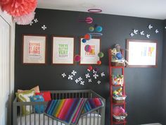 Adorable nursery! Slate walls with colorful accessories include handmade afghan blanket and mobile.   #kidsrooms #nursery