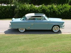 1954 Ford Plexiglas roof,very nice. My first car was a 1954 Ford that was this powder blue color, however, it did not have the very rare plexiglass roof panel. It was a 2 dr sedan Customline that I bought from the original owner for $350.00 and it needed nothing. I drove it for 3 years and sold it during my Sophmore year of college to buy the 1963 1/2  black Galaxie 500 Ford.