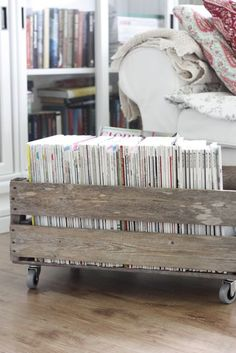 add wheels to a wooden crate for a magazine holder for the playroom/office