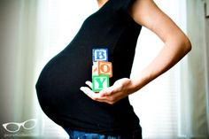 baby gender announcement. i like this better than the usual laying down with the blocks pose
