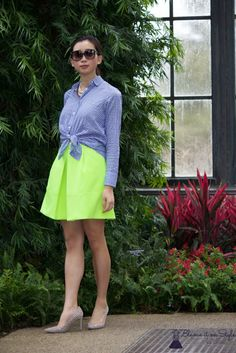 Style inspiration: knot a button-down shirt over a flared skirt
