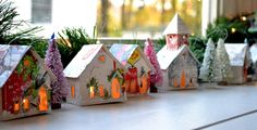 Create Your Own Putz Glitter House Village / Onaments that Light Up / Handmade from Vintage Christmas Cards. $42.00, via Etsy.