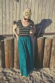 Add some neutral pieces to your inventory so you can pair them with fun colors like this teal Lucy Skirt.