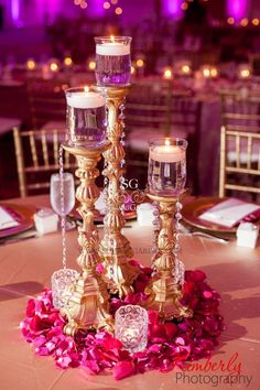 Simple candlestick centerpiece with surrounding flowers and votives, great indian wedding reception centerpiece idea, it's more cost effective than using full flowers Indian Wedding Decorations, Reception Decorations, Wedding Themes, Wedding Ideas, Indian Decoration, Pakistani Wedding Decor, Desi Wedding Decor, Backdrop Wedding, Reception Table