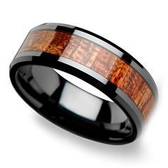 An inlay of mahogany hard wood with a mix of warm brown tones enhances this 8-millimeter-wide beveled black ceramic men's band.