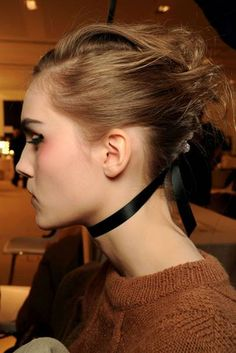 Bringing the classic wedding style bang up-to-date, this edgier take on the chignon is cool yet classy.