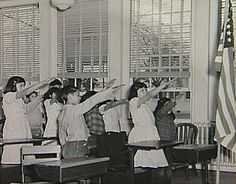 "The pledge of our grandparents. ""The original Bellamy salute, first described in 1892 by Francis Bellamy, who authored the original Pledge, began with a military salute, and after reciting the words ""to the flag,"" the arm was extended toward the flag.  In World War II, the salute too much resembled the Nazi salute, so it was changed to keep the right hand over the heart throughout."""