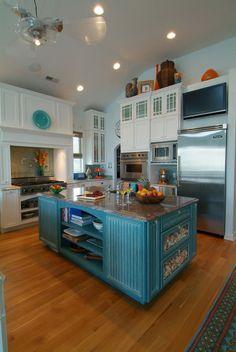 turqouise island in white kitchen.