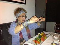 One of our favorite guests enjoying our Farmers Market Vegetable Plate.