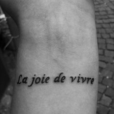 This is my first tattoo. Its on my left wrist. In English La joie de vivre means: The joy of living. I love the French language and I love life, so thats why I got it done. It is done by HP (Hien Phuoc Nguyen) who is the owner of Art of Ink in Aarhus, Denmark.